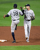 New York Yankees shortstop Didi Gregorius (18) and New York Yankees second baseman Tyler Wade (12) celebrate following their team's 90 - 0 win over the Baltimore Orioles at Oriole Park at Camden Yards in Baltimore, MD on Wednesday, July 11, 2018. The Yankees won the game 9 - 0.<br /> Credit: Ron Sachs / CNP<br /> (RESTRICTION: NO New York or New Jersey Newspapers or newspapers within a 75 mile radius of New York City)