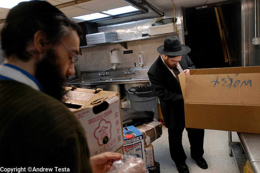 Rabbi Chaim Goldberg checks a delivery of fish at Eden Wok restaurant, Manhattan.©Andrew Testa