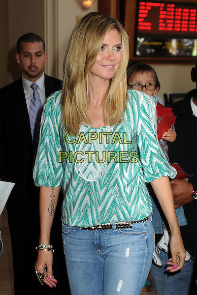 "HEIDI KLUM.""Hoodwinked Too! Hood Vs Evil"" Los Angeles Premiere held at the Pacific Theatre at The Grove,  Los Angeles, California, USA, 16th April 2011..half length jeans  green and white  print top  .CAP/ADM/BP.©Byron Purvis/AdMedia/Capital Pictures."