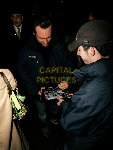 CHRISTIAN SLATER.Leaving the Ivy, London, UK..January 21st, 2006.Ref: SW.full length signing autograph fan.www.capitalpictures.com.sales@capitalpictures.com.©Capital Pictures.