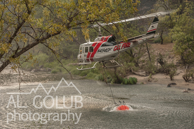 El Portal, California, August 25, 2011<br /> Motor Fire-About 12:00 pm August 25, 2011 a motor home caught fire in the Merced River Canyon on Highway 140 near the Cedar Lodge.  Quickly it spread to both sides of the Merced River in this very steep canyon.  The Stanislaus National Forest is on the north side of the river with the Sierra National Forest on the south side with Yosemite National Park only a few miles to the East.  At 6:00 pm the fire was approximately 1,200 acres at 0% contained.<br /> Photo/Al Golub/Golub Photography