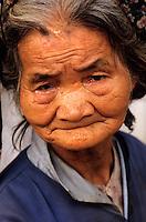 Portrait of a senior woman looking sad, Vietnam.