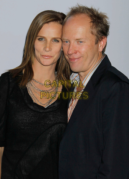 RACHEL GRIFFITHS & ANDREW TAYLOR .Attending Calvin Klein Collection and LOS ANGELES NOMADIC DIVISION present a celebration of L.A. Arts Month held at the Calvin Klein Store, Los Angeles, CA, USA, 28th January 2010..half length black couple necklace .CAP/ADM/MJ.©Michael Jade/Admedia/Capital Pictures