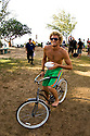 Kai Otton on his bicycle on the North Shore in Hawaii