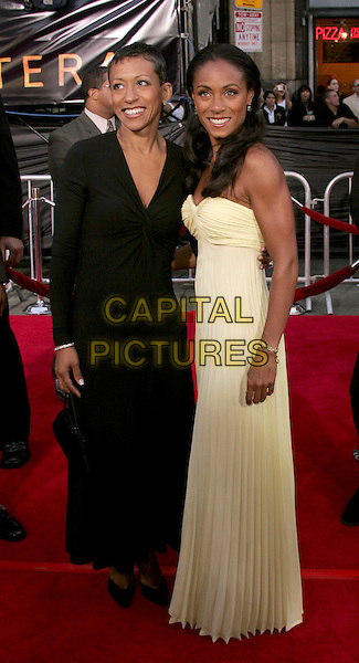 "JADA PINKETT SMITH & MOM ADRIENNE.The Los Angeles Premiere of ""Collateral"" held at The historic Orpheum Theatre in Downtown Los Angeles, California .August 2,2004.full length, mother, daughter, yellow, cream white pleated dress, folds.www.capitalpictures.com.sales@capitalpictures.com.Supplied By Capital Pictures"