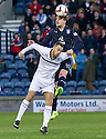 Dundee's Kyle Benedictus gets above Raith Rovers' Gordon Smith.
