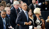 United States President Barack Obama looks on at a memorial for the victims of the Washington Navy Yard shooting at the Marine Barracks, September 22, 2013 in Washington, D.C.  The President and first lady also visited with families of the victims. <br /> Credit: Olivier Douliery / Pool via CNP
