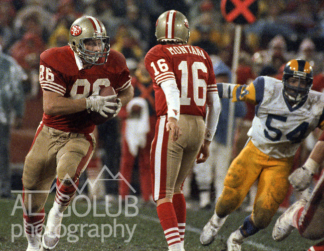San Francisco 49ers vs Los Angles Rams at Candlestick Park Sunday, December 27, 1987..49ers beat Falcons 48-0.San Francisco 49ers Quarterback Joe Montana (16) hand off to San Francisco 49ers Tight End John Frank (86)..
