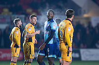 Aaron Pierre of Wycombe Wanderers exchanges a word with Darren Jones of Newport County on a cold night during the Sky Bet League 2 match between Newport County and Wycombe Wanderers at Rodney Parade, Newport, Wales on 22 November 2016. Photo by Mark  Hawkins.