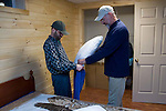 "Mark Pelletier, right, helps Timmy Barton set up the bed in his new room at the Pelletier home. The Pelletiers have run a day program for many of the men from Curt Brown's home, and knows them well. ""Curt and I are probably as close to brothers as you could get,"" says Mark, recognizing that moving day must have been sad for Curt, ""I only hoped that the fact that they were moving in with me would make that a little bit easier for him."""