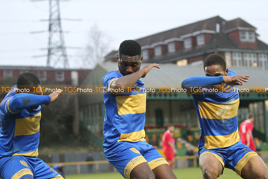 Chinedu Mckenzie of Romford scores the second goa and celebrates with Jonathan Adebayo and Kai Bichard  during Romford vs Wroxham, Ryman League Division 1 North Football at Ship Lane on 10th December 2016