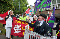 Pension aged members of the Southampton Labour Party stage some street theatre to protest against the council cuts and against bankers.