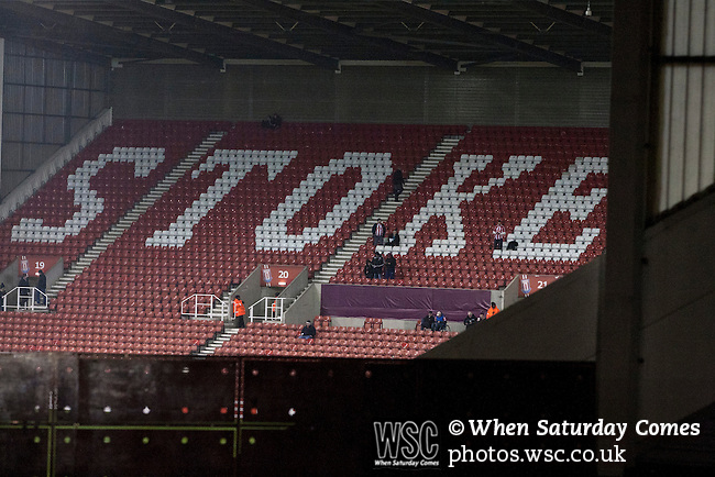 Stoke City 0 Valencia 1, 16/02/2012. Britannia Stadium, UEFA Europa League. Home supporters taking their seats in the deserted Boothen End stand of the Britannia Stadium, Stoke-on-Trent, before the UEFA Europa League last 32 first leg between Stoke City and visitors Valencia. The match ended in a 1-0 victory from the visitors from Spain. Mehmet Topal scored the only goal in the first half in a match watched by a crowd of 24,185. Photo by Colin McPherson.
