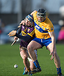 David Mc Inerney of Clare in action against Seamus Casey of Wexford during the Jack Lynch Memorial game at Tulla. Photograph by John Kelly.