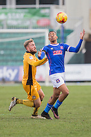 Reggie Lambe of Carlisle holds off Dan Butler of Newport County during the Sky Bet League 2 match between Newport County and Carlisle United at Rodney Parade, Newport, Wales on 12 November 2016. Photo by Mark  Hawkins.