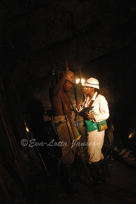 Cordelia (or Xoliswa) Vanda, 33, speaks to miner Mothlaodi Amos in the section she supervises at a Harmony Gold mine in Carltonville. Cordelia, who received her blasting certificate in 1996, shortly before the law prohibiting women from working underground was repealed, is now an acting mine overseer at Harmony.