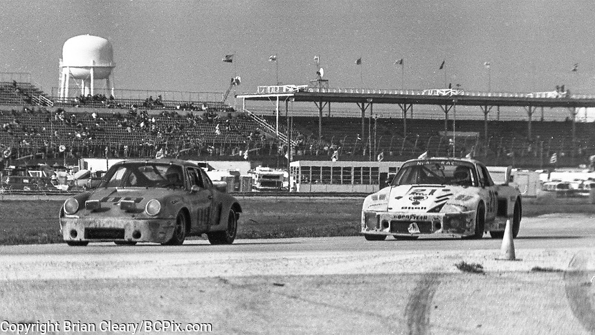 #09 Porsche 934 of Gary Belcher, Doc Bundy, and Al Holbert 6th place finish and the #21 Porsche 935 of  Volkert Merl, Reinhold Jöst, and Franz Konrad 13th place finish, 1978 24 Hours of Daytona, Daytona International Speedway, Daytona Beach, FL, February 5, 1978.  (Photo by Brian Cleary/www.bcpix.com)