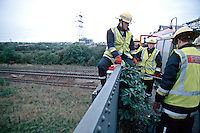Firefighters attending at incident where a person has been struck by a train. The only way to gain access is to climb down from a road overbridge by means of a rope and ladders. This image may only be used to portray the subject in a positive manner..©shoutpictures.com..john@shoutpictures.com