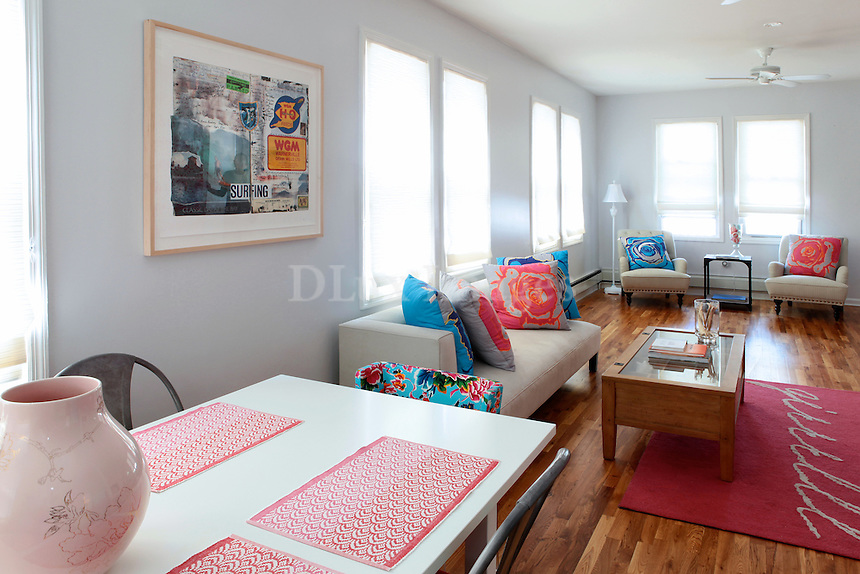 bright living room..Debra and Katherine Chen's Rockaways bungalow was transformed by husband and wife design team Robert and Cortney Novogratz into a girly beach retreat, replete with pink wallpaper, pink-painted floors, pink rugs and plenty of pink decorations.