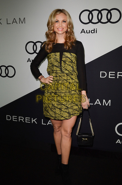 Fiona Gubelmann.Audi and Derek Lam Celebrate the 2012 Emmy Awards held at Cecconi's Restaurant, Los Angeles, California, USA..16th September 2012.full length green yellow print black clutch bag  dress hand on hip  .CAP/ADM/TW.©Tonya Wise/AdMedia/Capital Pictures.