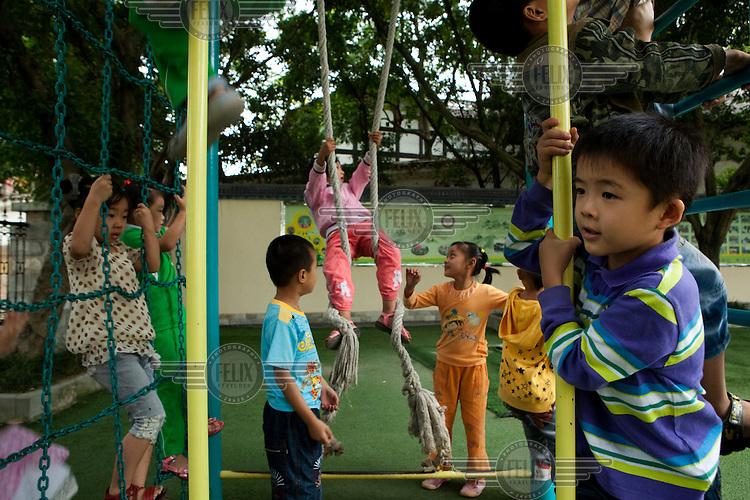 Children play at He Chuan Yucai School near Chongqing.
