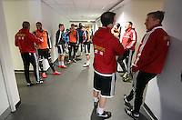 Wednesday, 23 April 2014<br /> Pictured: Head coach Garry Monk (R) in the tunnel with players before they take to the pitch. <br /> Re: Swansea City FC are holding an open training session for their supporters at the Liberty Stadium, south Wales,