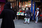 Bronx, New York<br /> April 25, 2020<br /> South Bronx<br /> <br /> People come out during quarantine at the epicenter of the coronavirus in New York City and the Untied States.