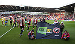 Players walk out past KIO banner during the English League One match at the Bramall Lane Stadium, Sheffield. Picture date: November 19th, 2016. Pic Simon Bellis/Sportimage