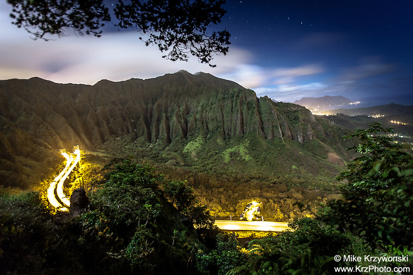 "An aerial view of the Ko'olau mountain range & H-3 freeway in Haiku valley at night from Haiku Stairs (""Stairway to Heaven"") hiking trail in Kaneohe, Oahu"
