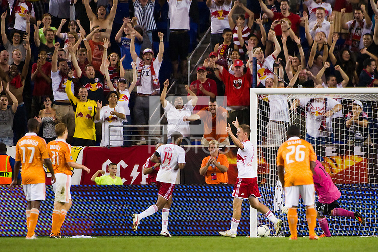 Jan Gunnar Solli (8) of the New York Red Bulls celebrates scoring. The New York Red Bulls defeated the Houston Dynamo 2-0 during a Major League Soccer (MLS) match at Red Bull Arena in Harrison, NJ, on August 10, 2012.