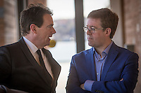 PQ candidate for the riding of Jean-Talon Clement Laberge and Leadership candidate Pierre-Karl Peladeau discuss during the presentation of parti Quebecois candidates for the upcoming byelection Tuesday May 5, 2015.