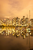 CANADA, Vancouver, British Columbia, looking across False Creek towards Yaletown at night, view from Charleson Park
