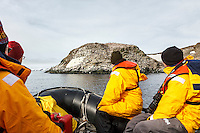 "Passenger from the ""Sea Spirit"" tour Aitcho Island in a Zodiac.  Aitcho Island is part of the South Shetland Islands near the Antarctic Peninsula."