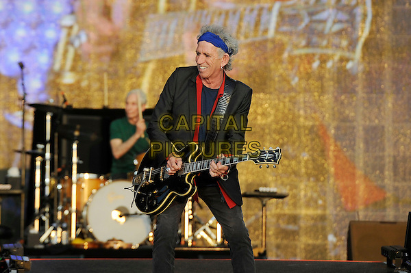 Keith Richards of The Rolling Stones <br /> performing at Barclaycard British Summertime, Hyde Park, London, England, UK, <br /> 13th July 2013.<br /> music concert gig festival live on stage half length blue head scarf red shirt grey gray blazer jacket playing guitar <br /> CAP/MAR <br /> &copy; Martin Harris/Capital Pictures