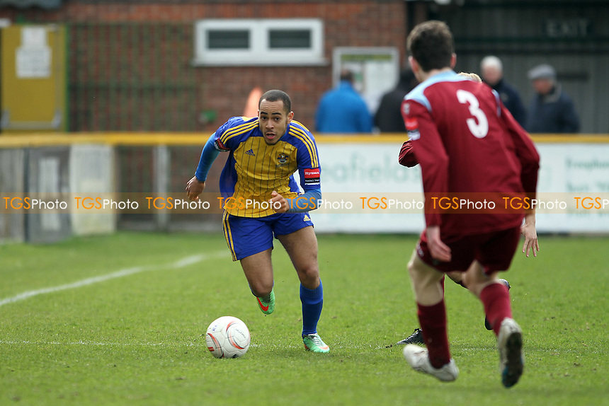 Callum Ibe of Romford runs with the ball - Romford vs Brentwood Town - Ryman League Division One North Football at Thurrock FC, Ship Lane, Purfleet - 04/04/15 - MANDATORY CREDIT: Mick Kearns/TGSPHOTO - Self billing applies where appropriate - contact@tgsphoto.co.uk - NO UNPAID USE