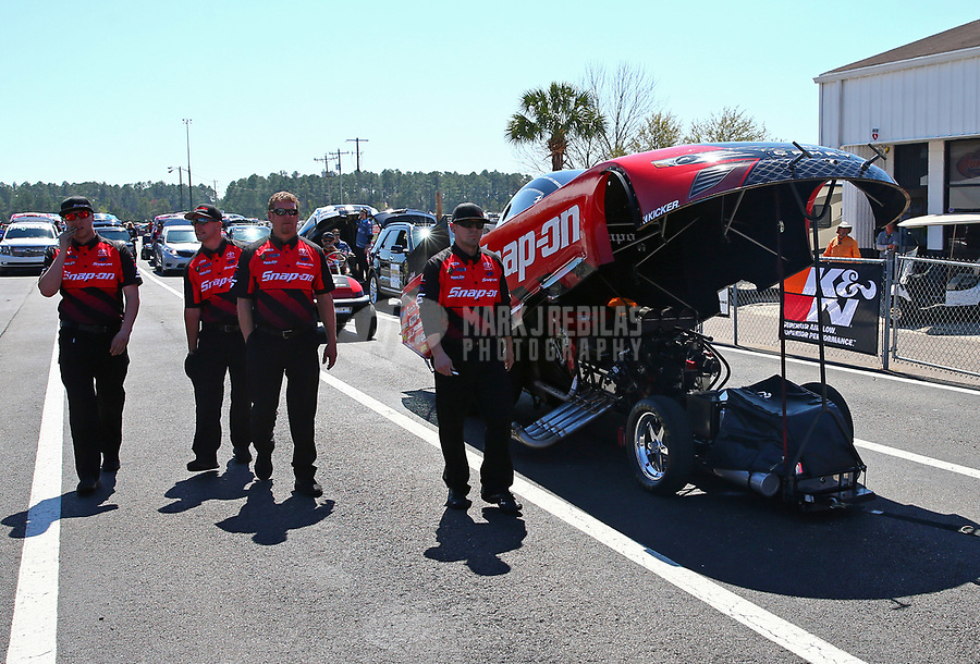 Mar 17, 2017; Gainesville , FL, USA; Crew members for NHRA funny car driver Cruz Pedregon during qualifying for the Gatornationals at Gainesville Raceway. Mandatory Credit: Mark J. Rebilas-USA TODAY Sports