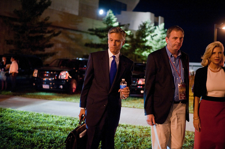 UNITED STATES - AUGUST 11:  Former Governor of Utah Jon Huntsman, left, waits to be picked up outside of Stephens Auditorium at Iowa State University after the Republican presidential debate in Ames, Iowa.  The debate featured eight republican candidates including Huntsman.   (Photo By Tom Williams/Roll Call)