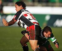Manawatu first five Aaron Cruden tackles Tasesa Lavea during the Air NZ Cup rugby match between Manawatu Turbos and Counties-Manukau Steelers at FMG Stadium, Palmerston North, New Zealand on Sunday, 2 August 2009. Photo: Dave Lintott / lintottphoto.co.nz