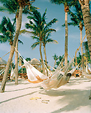 MEXICO, Maya Riviera, couple in a hammock relaxing, Xcaret