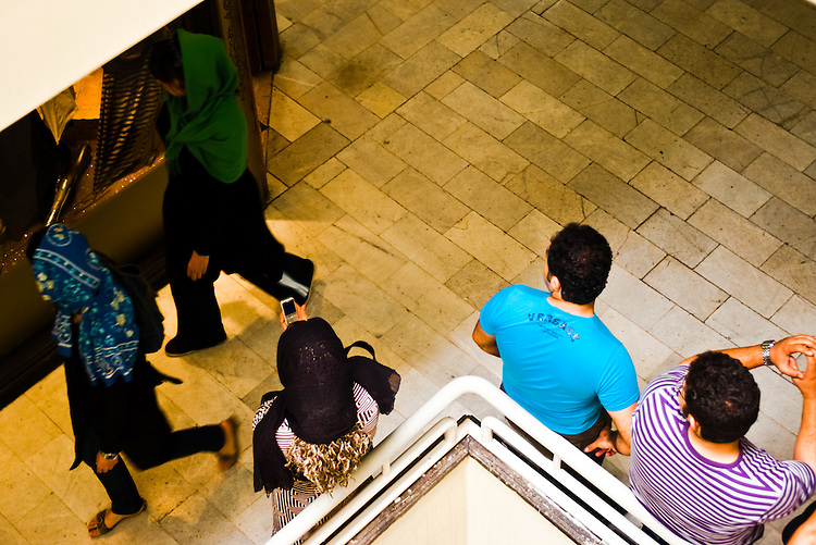 With a heavily conservative society, young iranians have few venues to meet members of the opposite sex. Spending hours in malls, boys and girls walk around each other to find someone they fancy before quickly exchanging phone numbers.