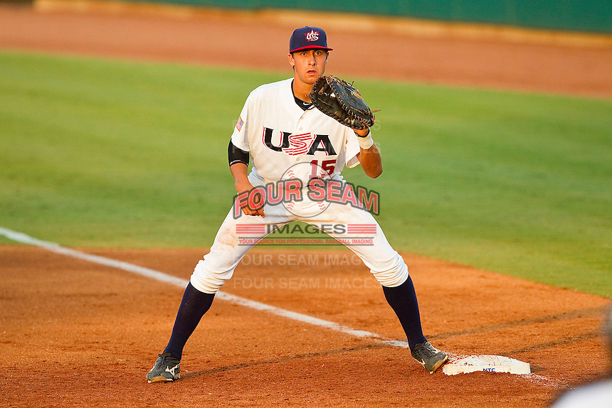 First baseman Joey Gallo #15 of the USA 18u National Team waits for a throw during the game against the USA Baseball Collegiate National Team at the USA Baseball National Training Center on July 2, 2011 in Cary, North Carolina.  The College National Team defeated the 18u team 8-1.  Brian Westerholt / Four Seam Images