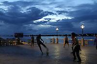 Young men are playing football along the Mekong river at Nong Khai, Thailande-2010