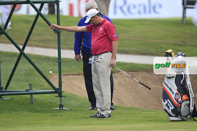 Peter Lawrie (IRL) gets a free drop to get a clear chip onto the 15th green during Friday's Round 2 of the 2013 Open de Espana at Campo de Golf Parador de El Saler. 19th Aprill 2013..Picture: Eoin Clarke www.golffile.ie.