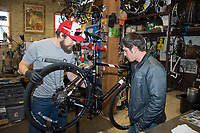 People try out bicycles at Machinery Row Bicycles on Saturday in Madison