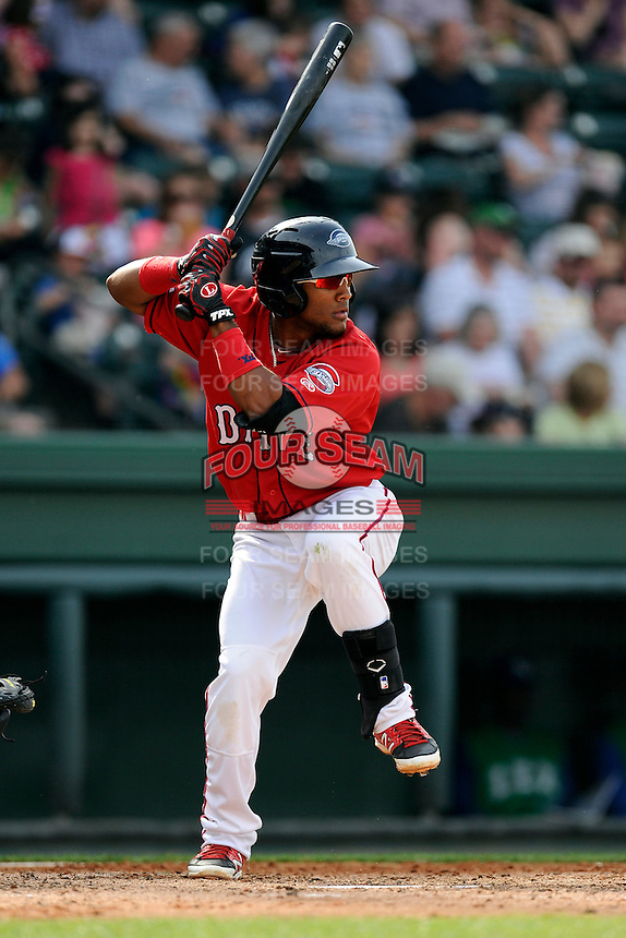 Second baseman Wendell Rijo (11) of the Greenville Drive bats in a game against the Lexington Legends on Sunday, April 27, 2014, at Fluor Field at the West End in Greenville, South Carolina. Rijo is the No. 18 prospect of the Boston Red Sox, according to Baseball America. Greenville won, 21-6. (Tom Priddy/Four Seam Images)