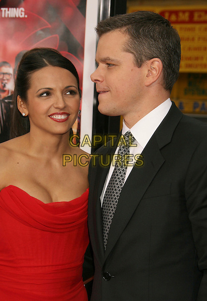 "LUCIANA BARROSO & MATT DAMON.""Ocean's Thirteen"" Los Angeles Premiere held at Grauman's Chinese Theatre, Hollywood, California, USA..June 5th, 2007.half length dress black suit jacket strapless married husband wife red lipstick profile .CAP/ADM/RE.©Russ Elliot/AdMedia/Capital Pictures"