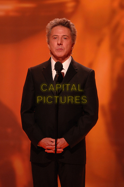"DUSTIN HOFFMAN.Telecast - 64th Annual Golden Globe Awards, Beverly Hills HIlton, Beverly Hills, California, USA..January 15th 2007. .globes stage microphone black suit jacket .CAP/AW.Please use accompanying story.Supplied by Capital Pictures.© HFPA"" and ""64th Golden Globe Awards"""