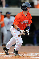 Greenville Astros catcher Brian Holberton #20 swings at a pitch during a game against the Kingsport Mets at Pioneer Park on August 4, 2013 in Greenville, Tennessee. The Astros won the game 17-1. (Tony Farlow/Four Seam Images)