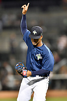 Starting pitcher Merandy Gonzalez (38) of the Columbia Fireflies shouts and points skyward in a game against the West Virginia Power on Thursday, May 18, 2017, at Spirit Communications Park in Columbia, South Carolina. Columbia won in 10 innings, 3-2. (Tom Priddy/Four Seam Images)