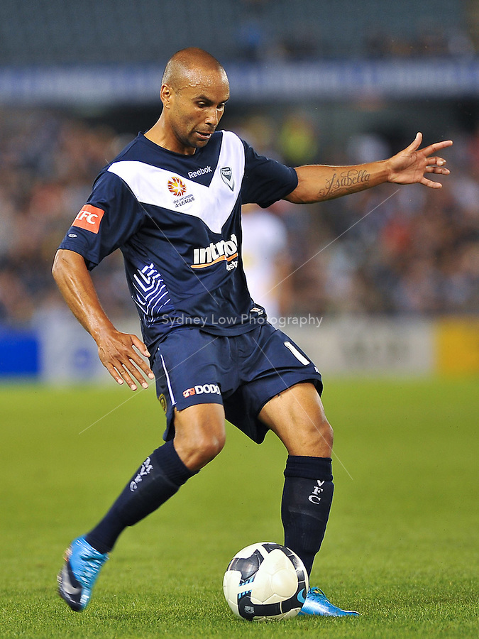 MELBOURNE, AUSTRALIA - NOVEMBER 28, 2009: Archie Thompson from Melbourne Victory kicks the ball in round 16 of the A-league match between Melbourne Victory and Gold Coast United at Etihad Stadium on November 28, 2009 in Melbourne, Australia. Photo Sydney Low www.syd-low.com